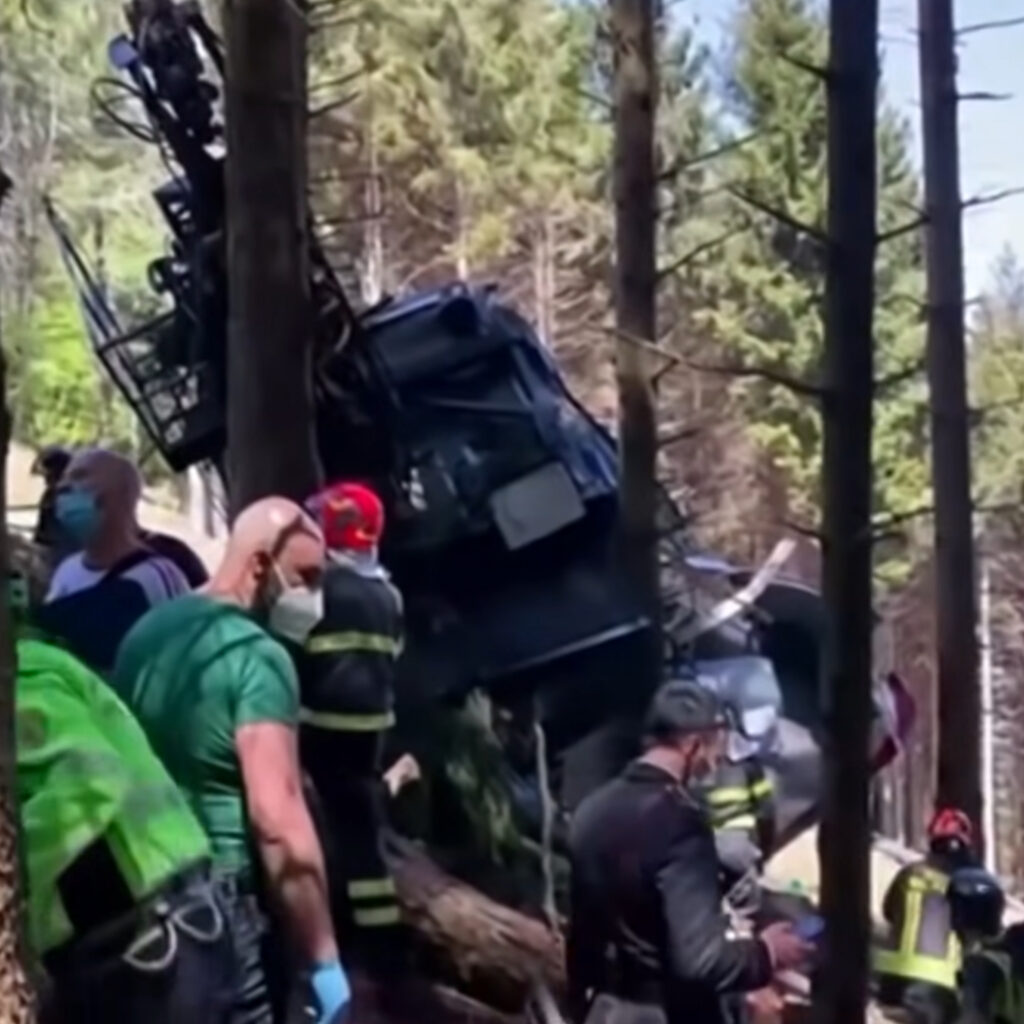 Emergency workers clear the wreckage of the Italian cable car accident that killed 14 people last month. 5-year-old Eitan Biran is the incident's sole survivor.