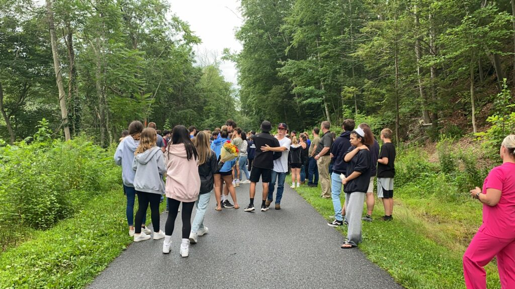 Anthony Nagore and Lucas Brewer were found dead in the Farmington River Monday after a four-day search for the missing teens. Mourners gathered at a memorial service for the boys after news broke that their bodies were found.