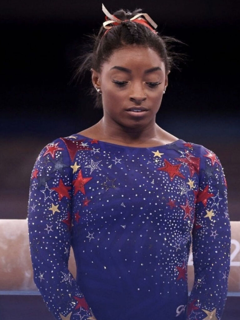 """Simone Biles feels the """"weight of the world"""" on her shoulders. The gymnast withdrew from the women's team competition due to her intense mental battle."""