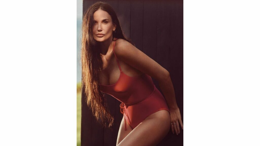 Demi Moore stunned fans with these sexy photos from a photoshoot for Andi's new TOGETHER swimsuit line. The 58-year-old wore a flaming red swimsuit and looked like she never aged. Don't we all wish we had her looks?